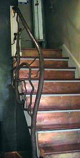 Copper Stair Treads and Iron Banister