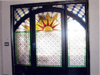 Custom Wrought Iron and Leaded Glass Entry Door